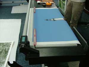 Canvas Stretch step 2 - Cut piece of canvas at least 3-4 inches